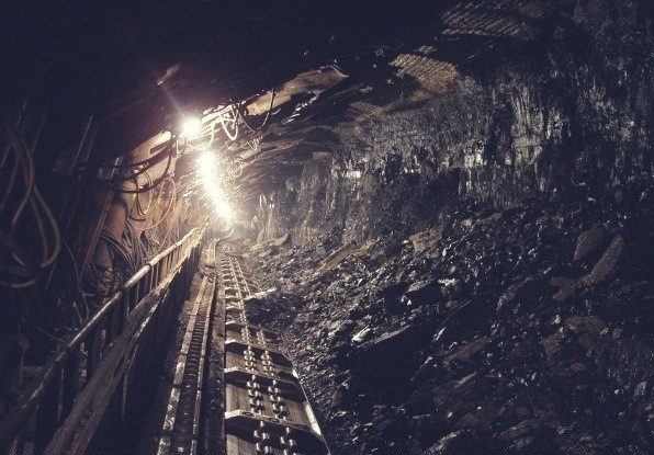 Image of tracks in a mine. Mining automation allows for miner safety.