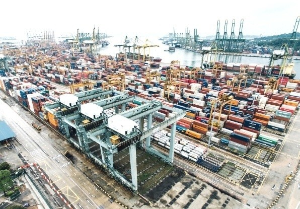 Image of complete port automation on straddle carriers and cargo loading machines at a large port environment.