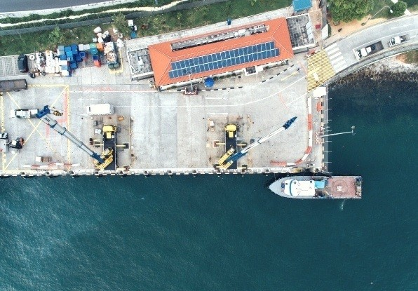Image of automation machines working at a small harbour