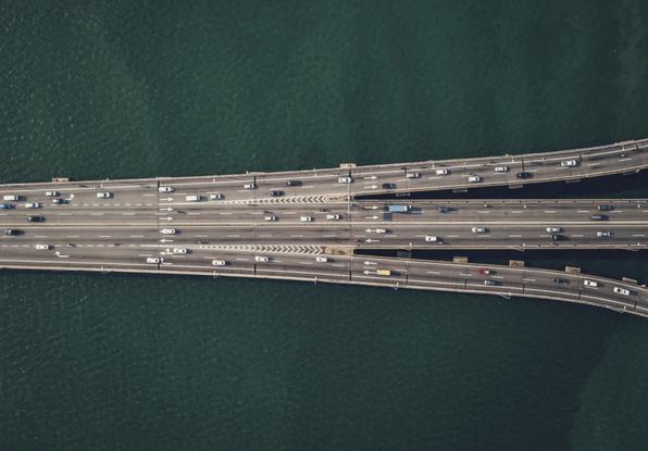 Image of vehicles crossing a bridge.